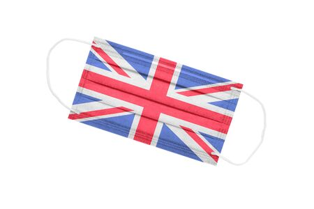 Medical mask with UK flag isolated on a white background. UK pandemic concept. attribute of coronavirus outbreak in the UK. Medicine in Great Britain.