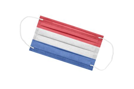 Medical face mask with flag of netherlands isolated on a white background. pandemic concept in the Netherlands. attribute of coronavirus outbreak in the Netherlands. Medicine in the Netherlands.