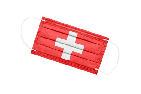 Medical face mask with flag of switzerland isolated on white background. pandemic concept in Switzerland. attribute of a coronavirus outbreak in Switzerland. Medicine in Switzerland.