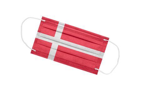 Medical face mask with flag of Denmark isolated on a white background. Denmark pandemic concept. attribute of a coronavirus outbreak in Denmark. Medicine in Denmark.