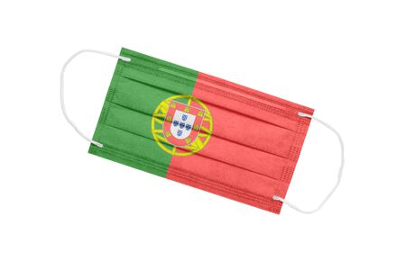 Medical face mask with flag of Portugal isolated on a white background. Portugal pandemic concept. attribute of a coronavirus outbreak in Portugal. Medicine in Portugal.