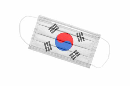 Medical face mask with flag of south korea isolated on white background. pandemic concept in south korea. attribute of coronavirus outbreak in South Korea. Medicine in South Korea.