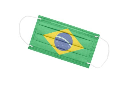 Medical face mask with flag of brazil isolated on a white background. Brazil pandemic concept. attribute of coronavirus outbreak in Brazil. Medicine in Brazil. 免版税图像