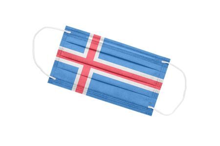 Medical face mask with flag of iceland isolated on a white background. pandemic concept in Iceland. attribute of coronavirus outbreak in Iceland. Medicine in Iceland. 免版税图像