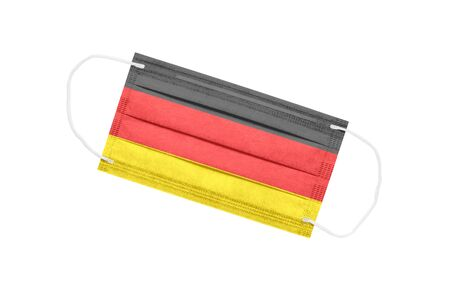 medical face mask with flag of germany isolated on white background. Germany pandemic concept. attribute of coronavirus outbreak in Germany. Medicine in Germany