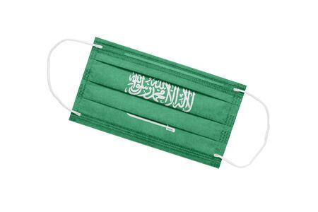Medical mask with flag of saudi arabia isolated on white background. Saudi Arabia Pandemic Concept. Attribute of coronavirus outbreak in Saudi Arabia. Medicine in Saudi Arabia. 免版税图像