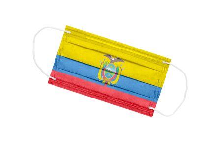 Medical mask with flag of Ecuador isolated on a white background. Ecuador pandemic concept. Coronavirus outbreak attribute in Ecuador. Medicine in Ecuador. 免版税图像