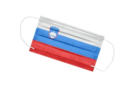 Medical mask with flag of Slovenia isolated on white background. Slovenia pandemic concept. Coronavirus outbreak attribute in Slovenia. Medicine in Slovenia.