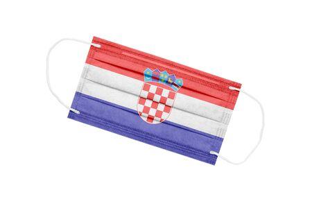 Medical mask with flag of Croatia isolated on white background. Croatia pandemic concept. Coronavirus outbreak attribute in Croatia. Medicine in Croatia.
