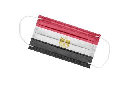 Medical mask with flag of egypt isolated on white background. The concept of the pandemic in Egypt. Attribute of a coronavirus outbreak in Egypt. Medicine in Egypt.