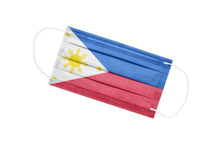 Medical mask with flag of philippines isolated on white background. Philippines pandemic concept. Coronavirus outbreak attribute in the Philippines. Medicine in the Philippines. 免版税图像