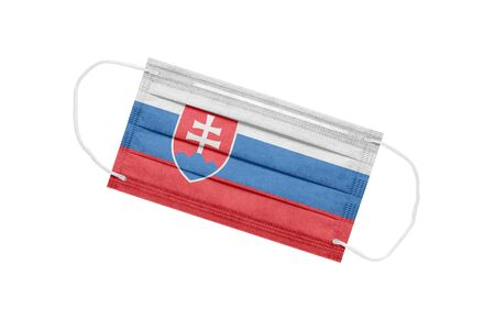 Medical mask with flag of Slovakia isolated on white background. Slovakia pandemic concept. Coronavirus outbreak attribute in Slovakia. Medicine in Slovakia.