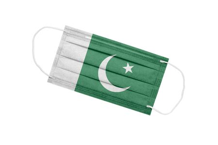 Medical mask with flag of Pakistan isolated on a white background. Pakistan pandemic concept. Attribute of coronavirus outbreak in Pakistan. Medicine in Pakistan.