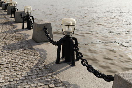 light chains: Columns with the chains at the embankment of Moskov River. Russia