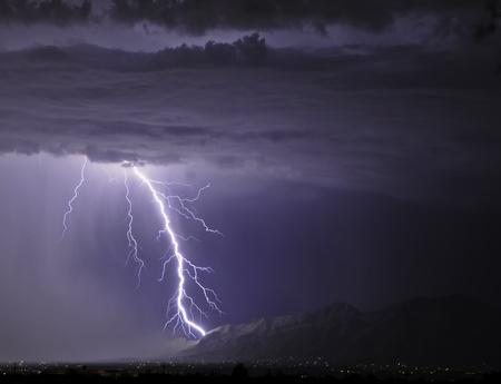 striking: Lightning striking the Catalinas
