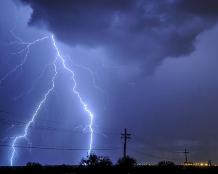 Lightning over power lines