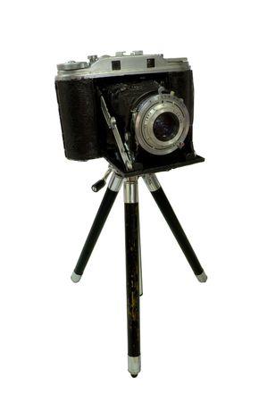 tripod mounted: Retro Camera attached to Tripod isolated