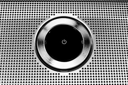 energy grid: Black Plastic Power Button close-up