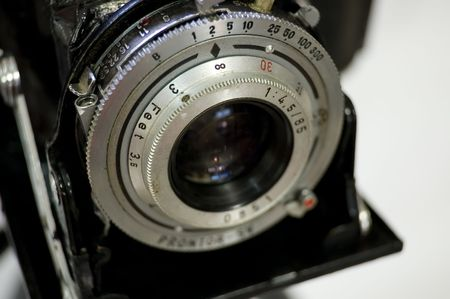 Vintage Camer Close Up - Shallow Depth of Field on white background Stock Photo - 387252