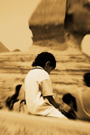 thoughful: A boy left alone near Sphinx, Giza, Egypt