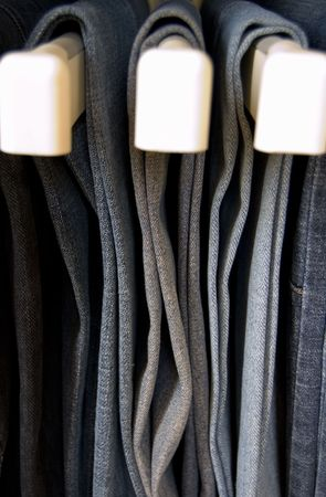 tight filled: Jeans hanging in closet Stock Photo