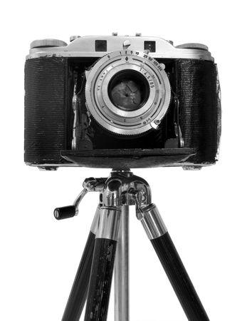 tripod mounted: Vinatage Camera on tripod over white background Stock Photo
