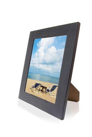 Beach Scenic inside modern photo frame over white background 免版税图像
