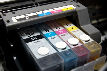 close-up shot of a CMYK ink cartridges for a color printer Stock Photo - 435714