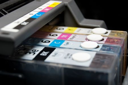 printing press: close-up shot of a CMYK ink cartridges for a color printer Stock Photo