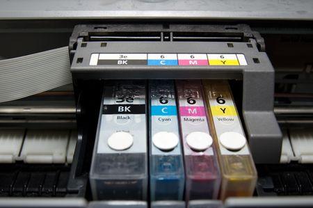 bubblejet: close-up shot of a CMYK ink cartridges for a color printer Stock Photo