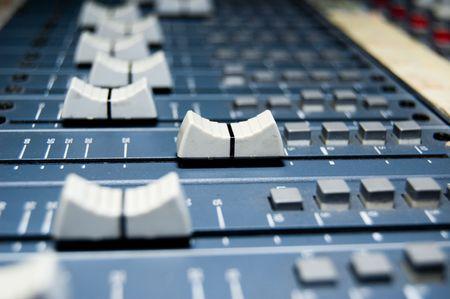 eq: closeup of a studio mixer