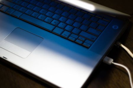 Laptop Keyboard with blue light from lcd photo
