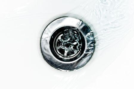Down the drain.