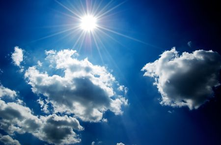 Cloudscape with bright sun and blue sky. Stock Photo - 646893