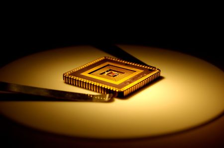 compute: Extreme close-up of computer micro chip . Stock Photo