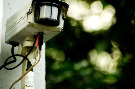 Motion Sensor mounted on the wall. Stock Photo