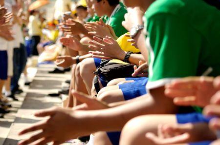 Students Cheering schoold sport event.