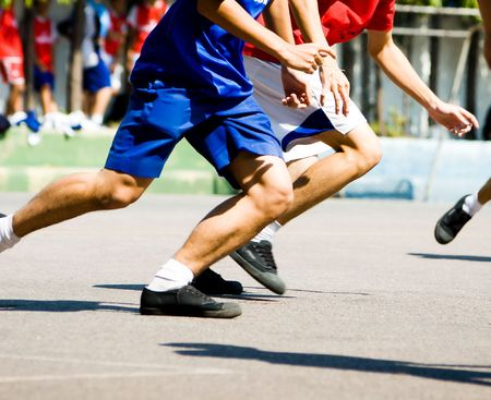 Two Players running for the ball.