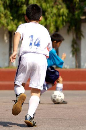 Kids playing soccer.