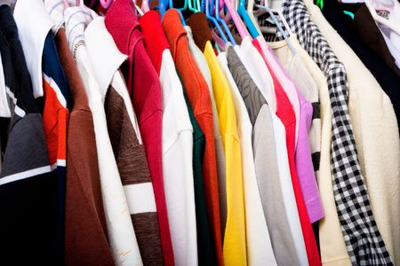 Multi colored shirts on hangers.