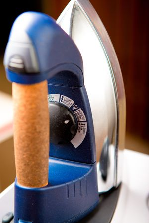 Dusty Iron inside home environment. Focused on temperature control knob. Stock Photo