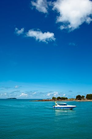 Blue Sea with speed boat in the foreground Stock Photo