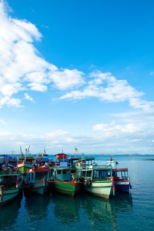 Blue Sea with fishing boats in foreground Stock Photo