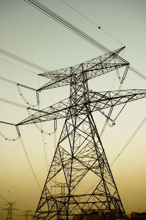 high voltage electricity pylons near dusk Stock Photo