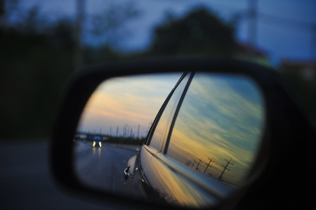 rear views: View of a sunset from side mirror.