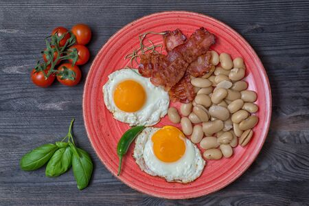 Farmer meals bean eggs bacon tomatto basilico cherry tomatto top view