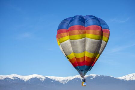 Hot air Baloon in the beatiful mountain in the winter colorfull