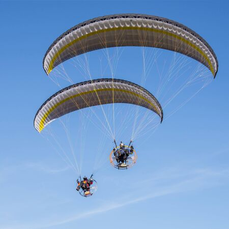 Two paraglider blue sky moto color