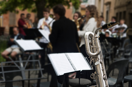 playing folk: detail of a saxophone at a concert Stock Photo