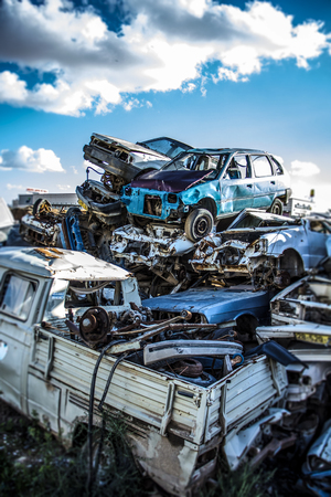 corroding: Discarded cars on junkyard